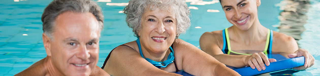 three older people in a swimming pool